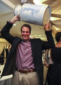 Norwell Citizen of the Year 2015 Glenn Ferguson holds the milk carton from the Norwell Chamber of Commerce over his head. Wicked Local Staff Photo/Alyssa Stone
