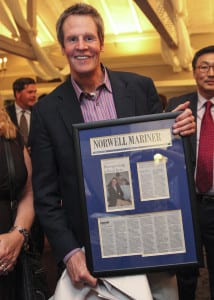 Glenn Ferguson's employee's gifted him with the article in the Norwell Mariner written about him framed and mounted at the Norwell Citizen and Business of the Year 2015 at the Barker Tavern. Wicked Local Staff Photo/Alyssa Stone